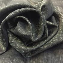 Подкладка жаккардовая серого цвета с мелкими огурцами