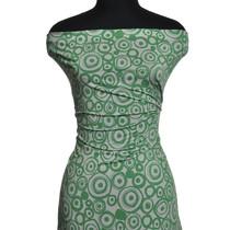 Скользкий синтетический трикотаж белого цвета с зелеными узорами