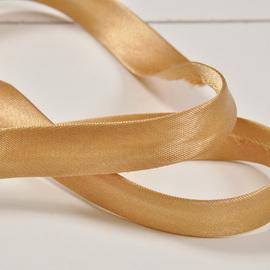 Золотисто-бежевая тесьма для обработки края изделия