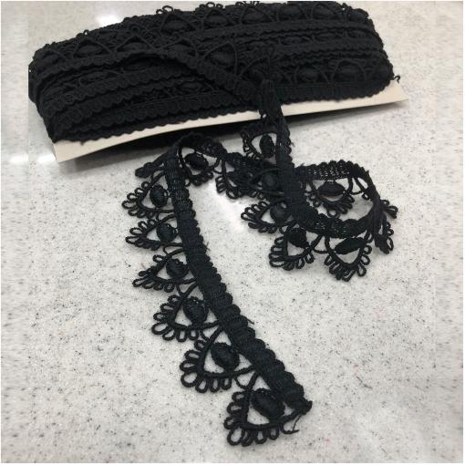Тесьма кружевная шерстяная черного цвета с ажурными уголками