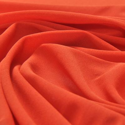 Вискозный однотонный трикотаж кораллово-терракотового цвета