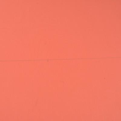 Вискозный однотонный трикотаж кораллового цвета скользкий