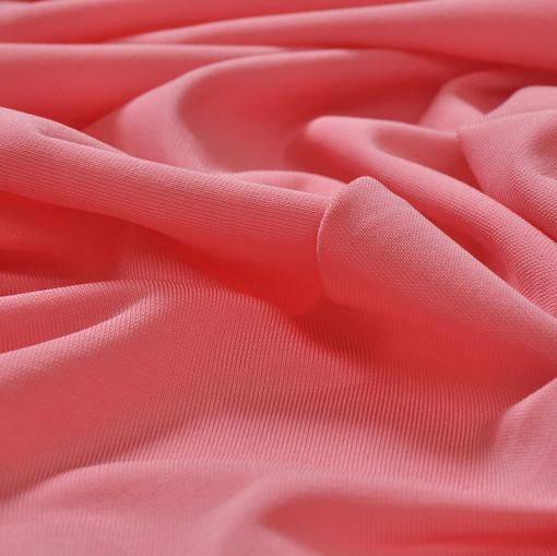 Вискоза-стрейч кораллового цвета с розовым оттенком