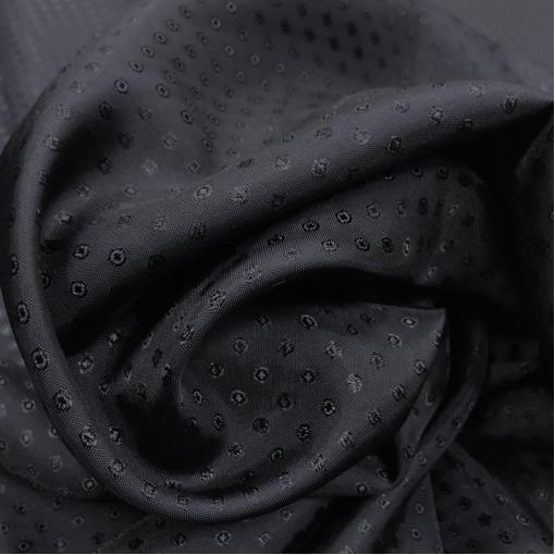 Подкладка вискозная жаккардовая темно-синего цвета в мелкий горошек