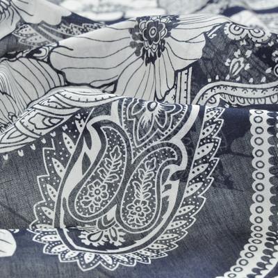 Хлопок батист с белым рисунком в виде огурцов и цветов на синем фоне