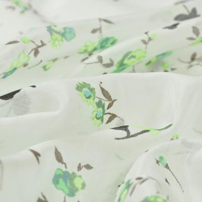 Батист белого цвета в мелкие салатовые цветы