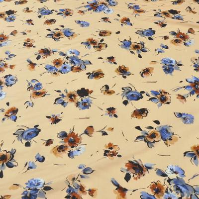Вискоза бледно-оранжевого цвета, плательная в синие и коричневые цветы
