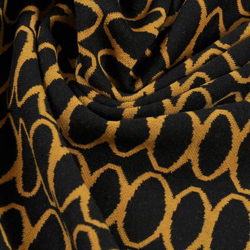 Джерси стрейч черного цвета с бесконечным оранжевым рисунком