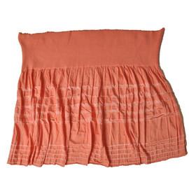 Юбка насыщенного красно-оранжевого цвета из трикотажного полотна
