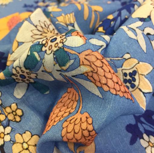 Хлопок тонкий принт Ferretti желто-оранжевые цветы на голубом фоне