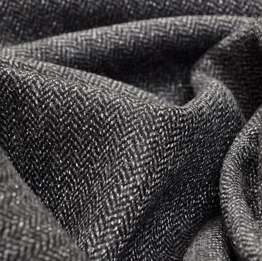 Костюмный твид в мелкую черно-серую елочку.
