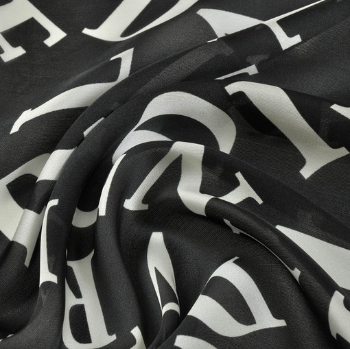 Шелк черный полуматовый крепдешин с буквами