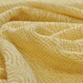 Шерстяной фактурный трикотаж желтого цвета