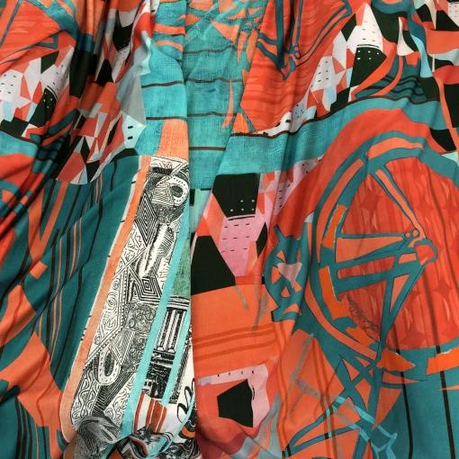 Трикотаж вискозный с отливом стрейч дизайн Save the Queen бирюзово-коралловая абстракция