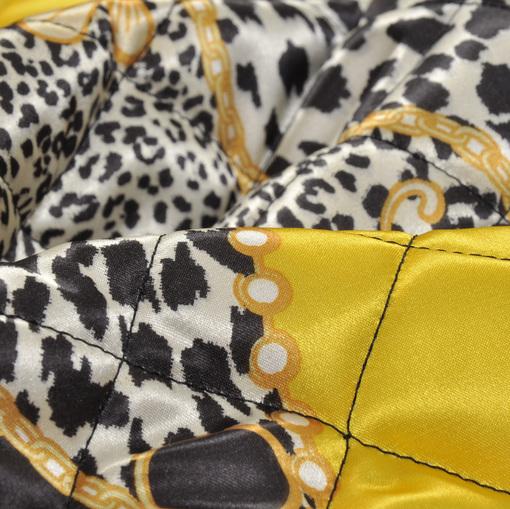 Стеганная курточная ткань с абстрактным рисунком в желтых тонах