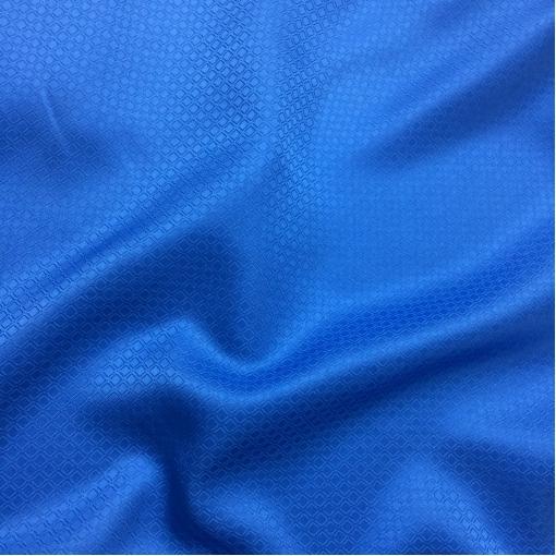 Шелк жаккардовый в мелкий ромбик яркого синего цвета