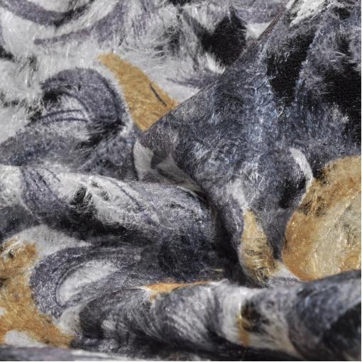 Пальтовая ткань с тисненым рисунком из волосков желтого цвета