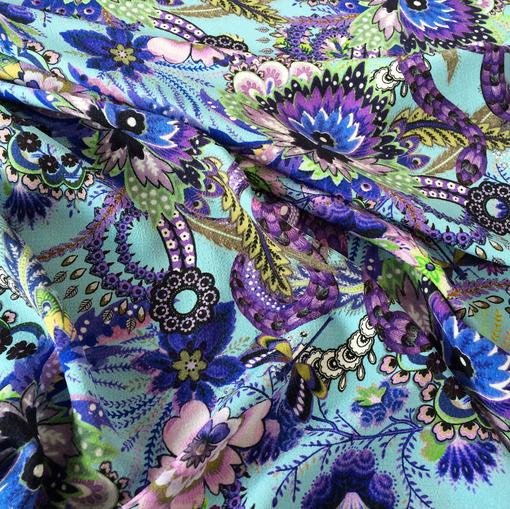 Вискоза плательная принт Rochas синие цветы на голубом фоне