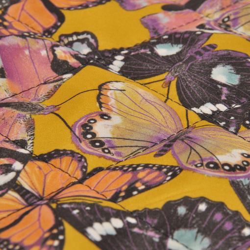 Курточная стеганная двухсторонняя ткань в желтых тонах с бабочками