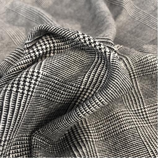 Твид костюмный шерстяной стрейч Christian Dior клетка черно-молочного цвета