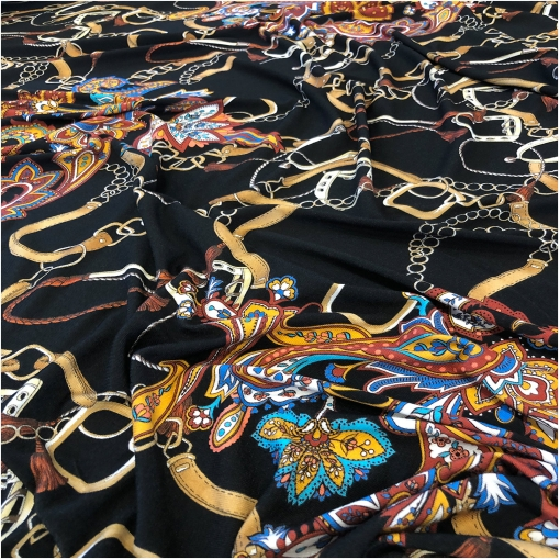 Трикотаж  вискозный  стрейч дизайн Elisa Fanti пейсли, ремни и цепи на черном фоне