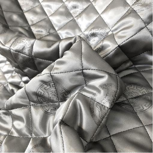 Ткань курточная двухсторонняя стежка принт Versace логотипы на серебристом фоне