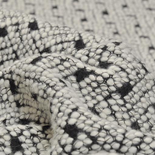 Шерстяной жаккард с белым вытканным рисунком на черном фоне