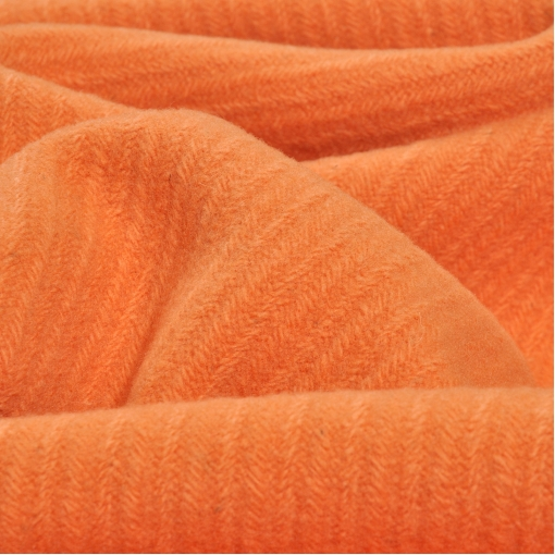 Пальтово-костюмная мягкая ткань грязно оранжевого цвета с вывязанным рисунком в виде диагональных полос