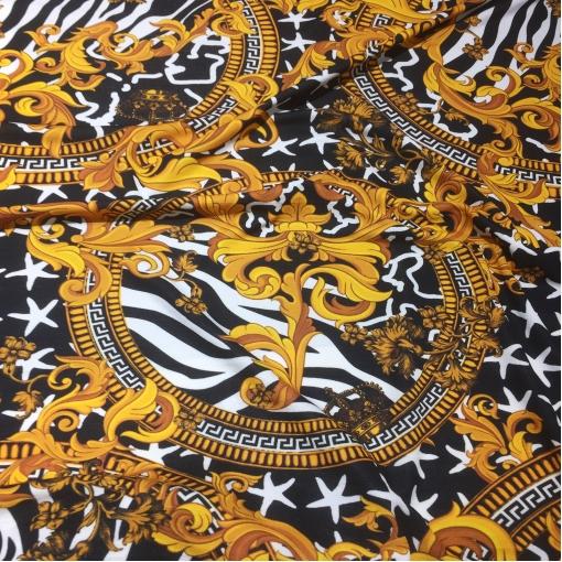 Трикотаж вискозный скользкий принт Versace вензеля на черном фоне