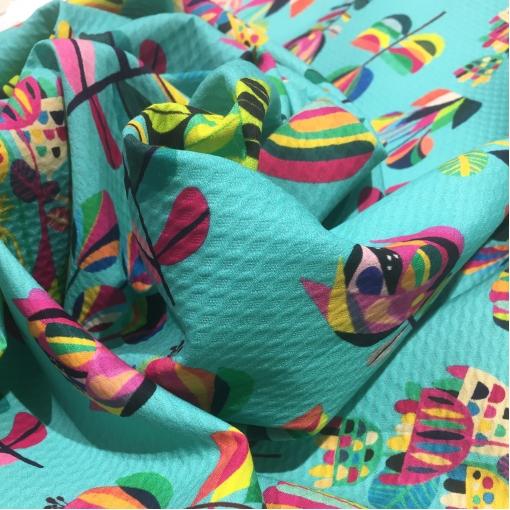 Жаккард х/б костюмно-плательный принт абстрактные цветы на бирюзовом фоне