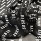 Шелк шифон принт Versace логотипы на темно-сером фоне