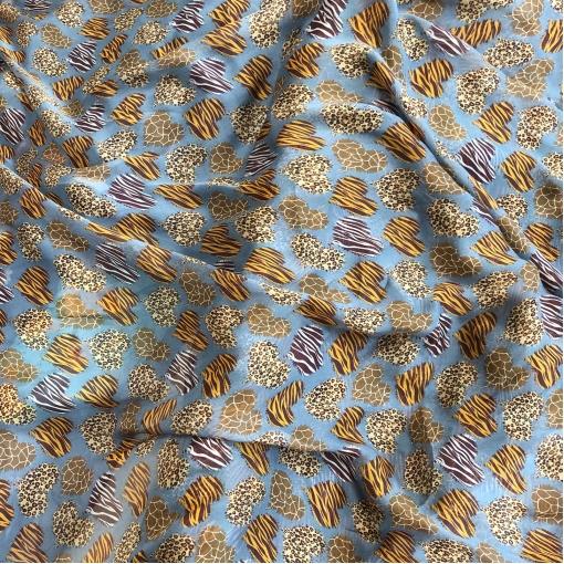 Шелк шифон принт Moschino анималистические сердца  на голубом фоне