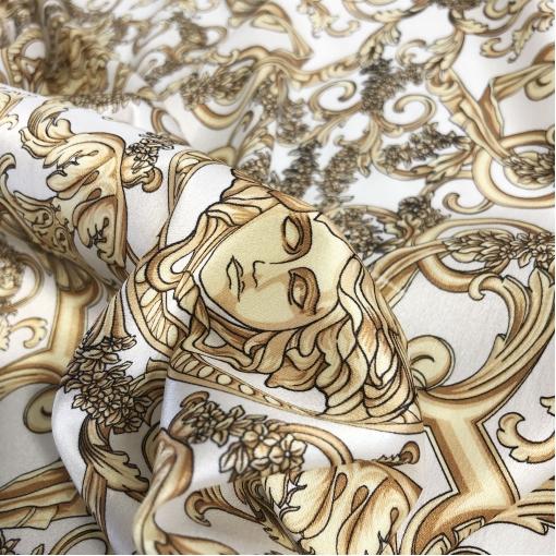Шелк атласный стрейч принт Versace логотипы и вензеля на молочном фоне