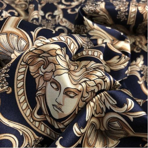 Шелк атласный стрейч принт Versace логотипы и вензеля на темно-синем фоне