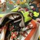Шелк атласный стрейч принт Ferragamo геометрия и цветы в апельсиново-черных тонах
